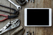 Old tools and tablet on a wooden table - 81941771