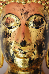 Close up Buddha face statue, Thai style.