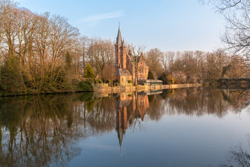 Medieval Castle on Love lake, Minnewater Park in Bruges, Belgium
