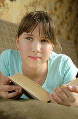 The Girl dreams over book