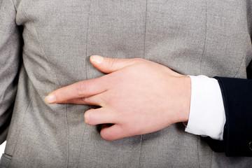 Businesswoman lying fake hand fingers crossed.