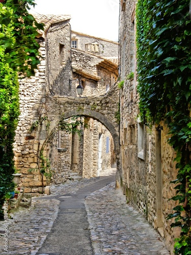 Beautiful arched cobblestone street, Provence, France - 81943325