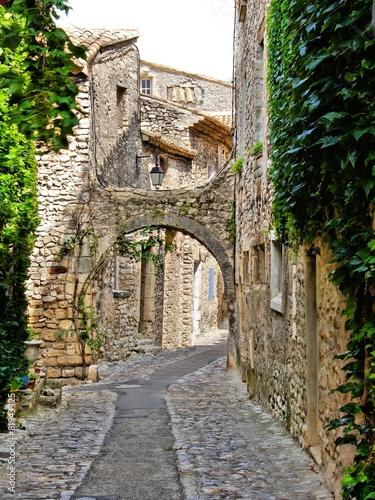 Fototapeta Beautiful arched cobblestone street, Provence, France