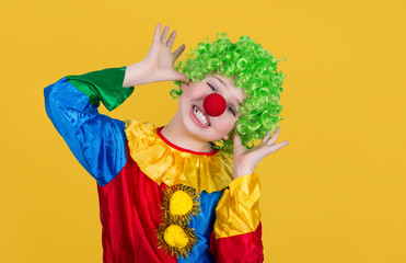 Funny clown isolated on yellow background. Closeup of little clo