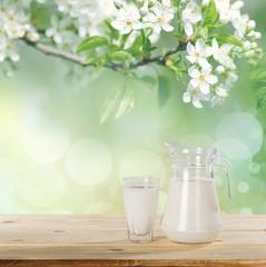 Milk. Milk on table and sunny trees