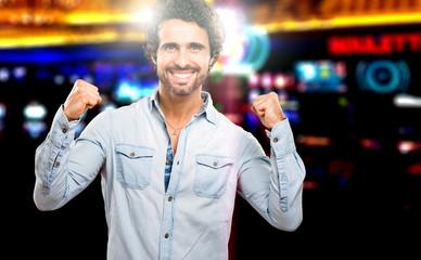Handsome man winning at the casino