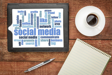 social media word cloud on digital tablet