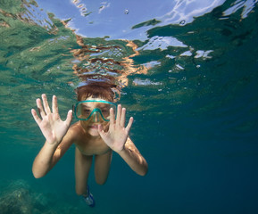 Little boy snorkeling in a sea