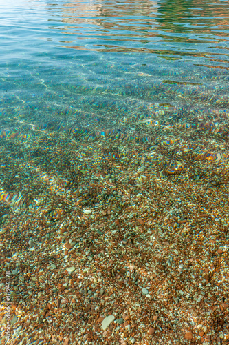 Pebbles seen through clear water © master1305