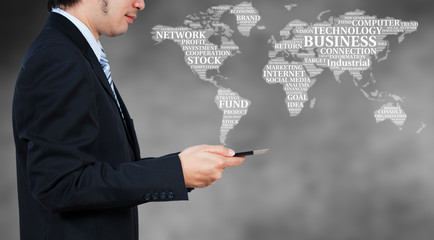 Businessman using tablet with word cloud, business globalization