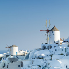 white city and mills on Santorini in Greece