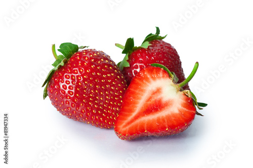 Ripe strawberries on white background - 81947334