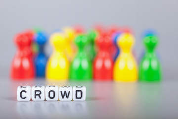 Cube Letters show crowd  in front of unsharp ludo figures