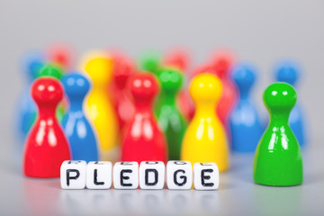 Cube Letters show pledge  in front of unsharp ludo figures