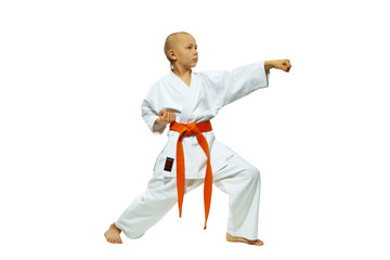 The boy with a red belt hits a hand into air
