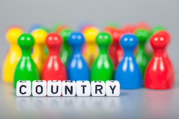 Cube Letters show country  in front of unsharp ludo figures