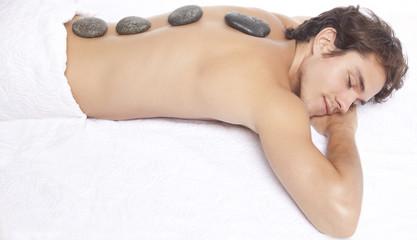Young man enjoying spa treatment