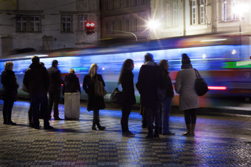 People in prague waiting for tram