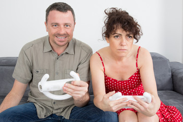 Man and woman, having fun playing video console games