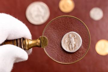Examining Roman silver coin