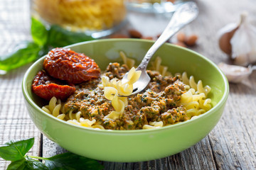 Pasta with pesto with dried tomatoes, garlic and chili.