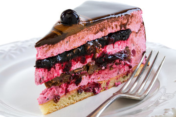 Piece of cake with souffle and jelly berries close up.