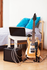 Guitar with an amplifier at home