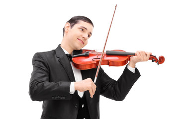 Elegant musician playing an acoustic violin