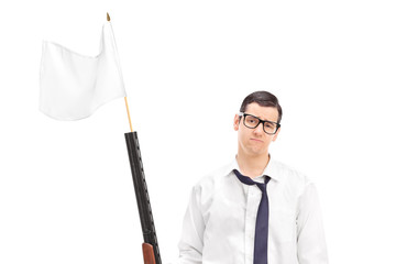 Sad guy holding a rifle with white flag attached on it