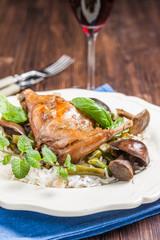 braised rabbit leg with mushrooms, green beans and basmati rice