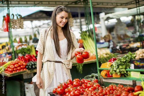 Young woman on the market - 81950115