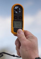 Anemometer in the hand of man,  wind speed 14.4 ms . Clouse-up