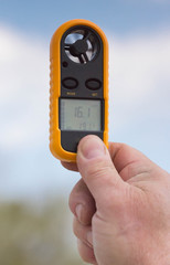 Anemometer in the hand of man,  wind speed 16.1 ms . Clouse-up