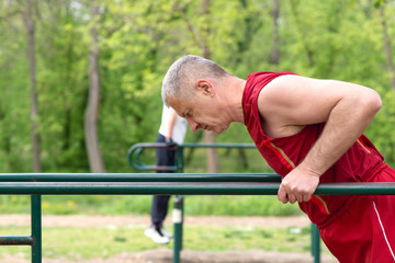 Senior  Exercising In Sport  Park