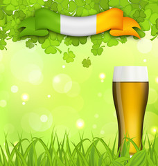 Glowing nature background with glass of beer, clovers, grass and