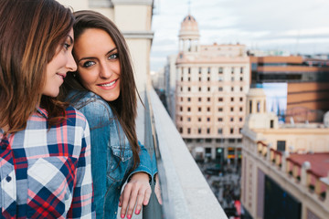 Two Cute Girls Having Fun in a City Viewpoint