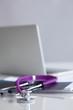 Violet stethoscope near laptop computer - 81952157