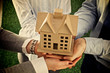 Group of businesspeople holding model house - 81952362