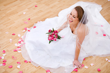 Bride: Laughing Bride On Floor With Petals Around