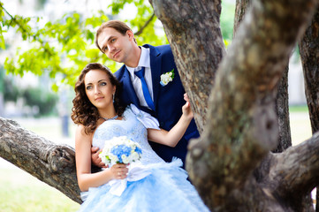 bride and groom outdoors park under trees