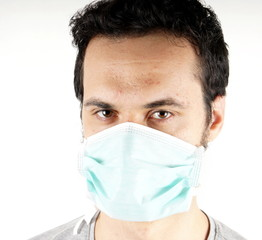 Studio shot of a young man with surgical mask