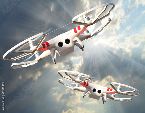 Two drones against stormy sky.