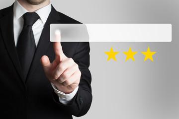 businessman pushing flat button three golden rating stars