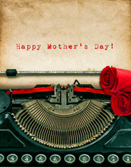 Vintage typewriter and red rose flowers. Happy Mothers Day