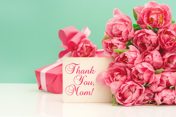 Pink tulips, gift ang greeting card. Mothers Day concept