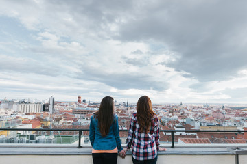 Two Girls Looking at City Views