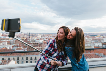 Two Cute Girls Having Fun with a Selfie Stick