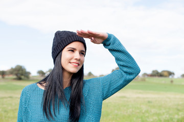 Girl with wool cap in the field