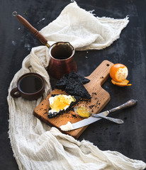 Breakfast set. Black bread toasts with tangerine marmelade and