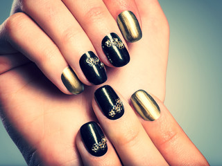 Beautiful woman's nails with beautiful creative manicure